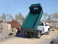 E-Tipper shown with an aerodynamic tapered cab shield, one-piece seamless sides to limit corrosion and fold-down sides for increased accessibilty.