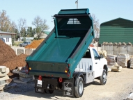 E-Tipper 2-3 yard body with fold-down sides shown with optional poly side boards, Minimizer fenders and manual tarp.