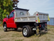 E-Tipper 2-3 yard body with optional full height front board pockets, vertical side and tailgate braces and manual tarp.