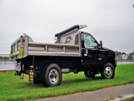 Stainless Steel E-Tipper construction includes front, sides, tailgate and floor. Shown with optional vertical side and tailgate braces, full height front board pockets and manual tarp.