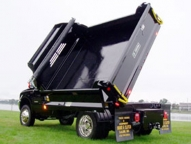 Dump in two directions! Side dumping with the Deuce is ideal for hard to reach places.