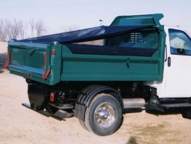 Optional tarp accessory includes integrated roll-up mechanism and tie down hooks.