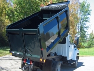 Landscape Tipper shown with optional 12-gauge two-piece rear barn doors with single lever locking mechanism.