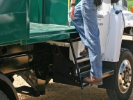 Stow-away ladder offers quick and easy access to front of landscape body.
