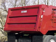 Select options shown here include the sloped asphalt tailgate, rigid ladder and walkrail.