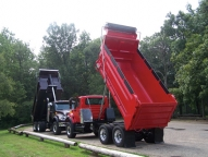 This sloped rear Select body in traditional (square) style uses a Crysteel's Marathon telescopic hoist.