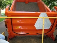 To stop the flow of pea gravel with the High 'N Slide tailgate you only have to lower the tailgate to stop the flow in the sliding mode.